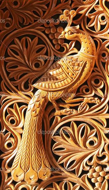wood carving, the mythological bird on the abstract floral background